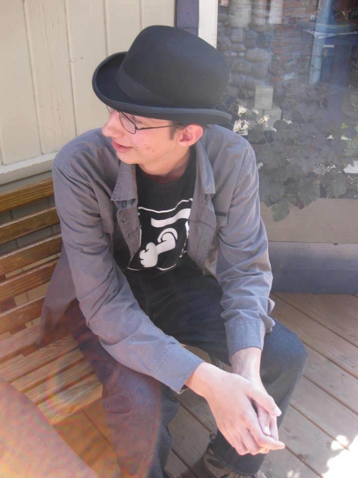 John in His Familiar Bowler Hat